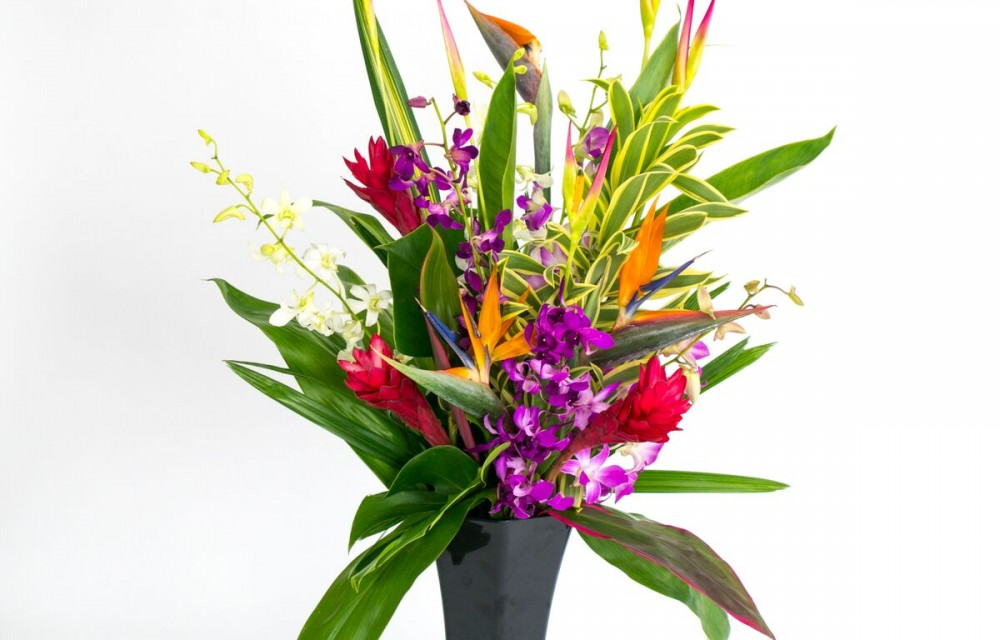 hawaiian flowers in black vase